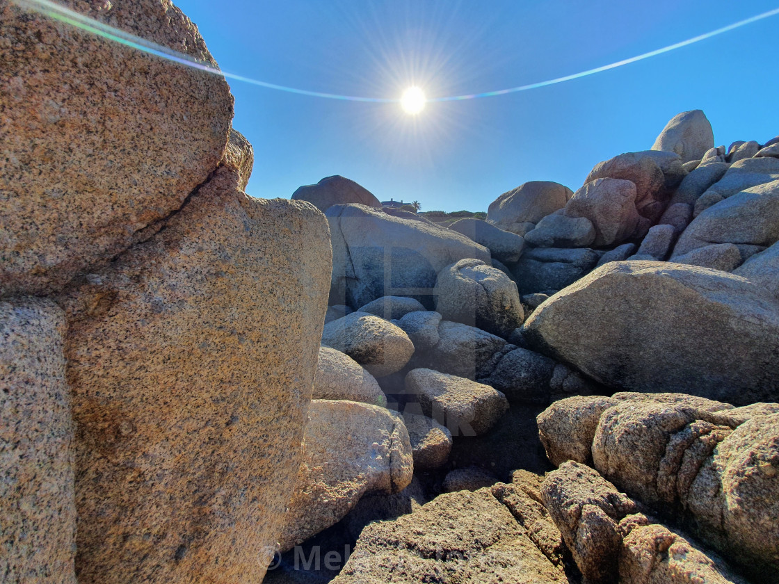 """Port Elliot rocks and sun South Australia"" stock image"