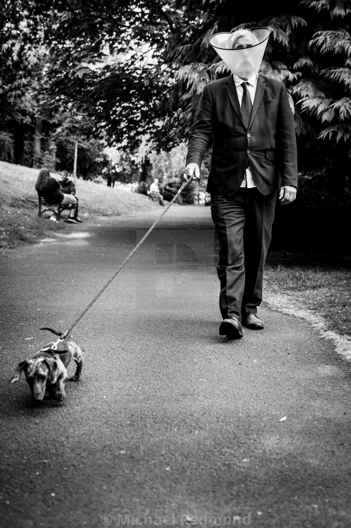 """""""Walking the dog."""" stock image"""
