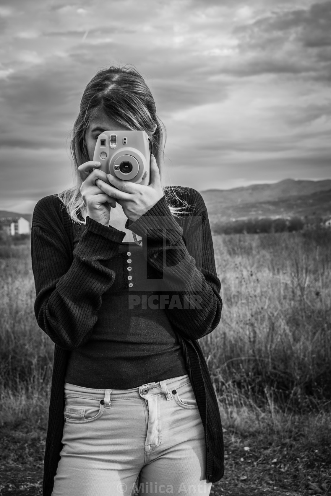 """Woman photographing while standing on field"" stock image"