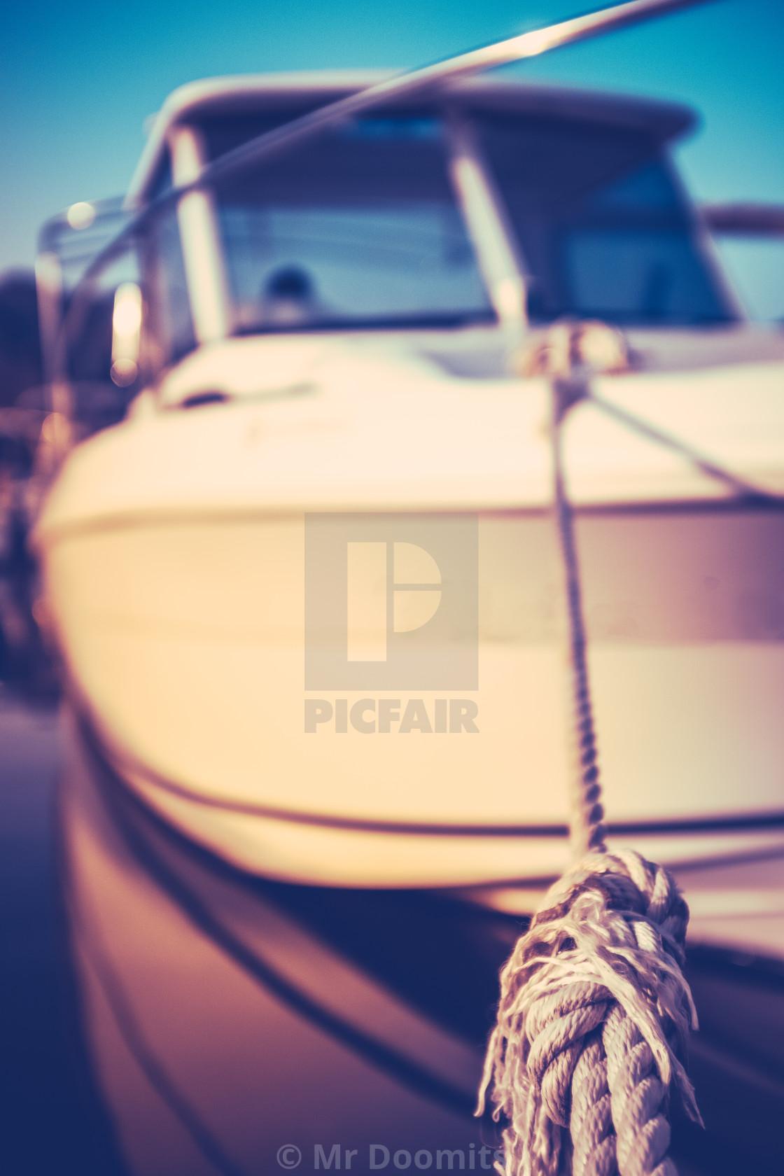 """Moored Luxury Yacht At Sunset"" stock image"