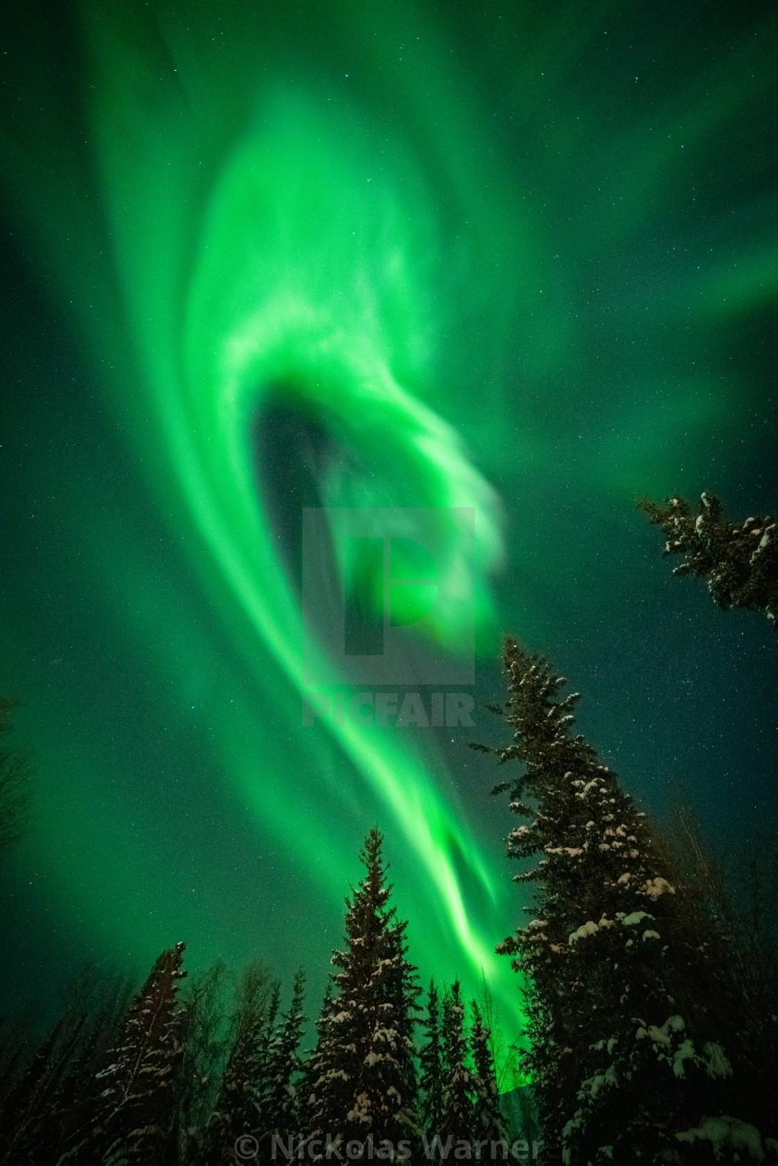 """Glowing Green Aurora Formation in Arctic Alaska"" stock image"