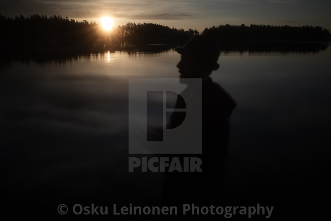 """A Man With A Hat I (At The Lake In Morning)"" stock image"