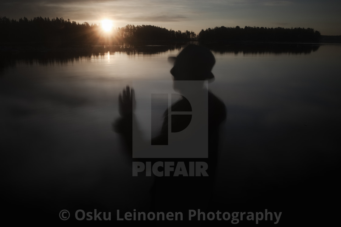 """A Man With A Hat IV (At The Lake In Morning)"" stock image"