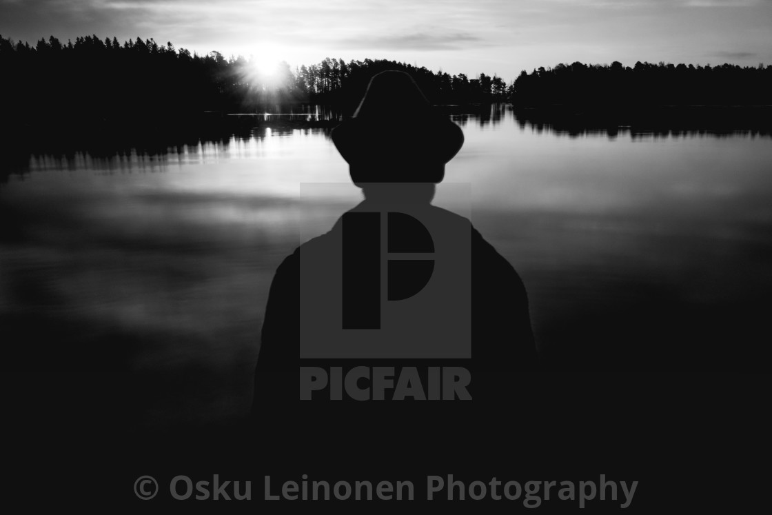 """A Man With A Hat VI (At The Lake In Morning)"" stock image"