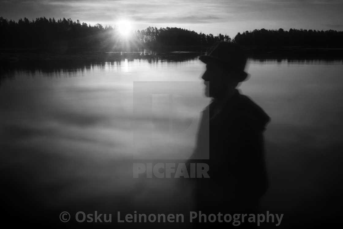 """A Man With A Hat II (At The Lake In Morning)"" stock image"