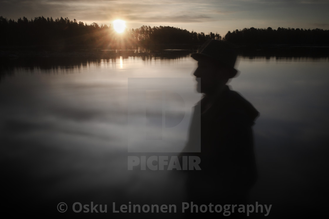 """""""A Man With A Hat V (At The Lake In Morning)"""" stock image"""