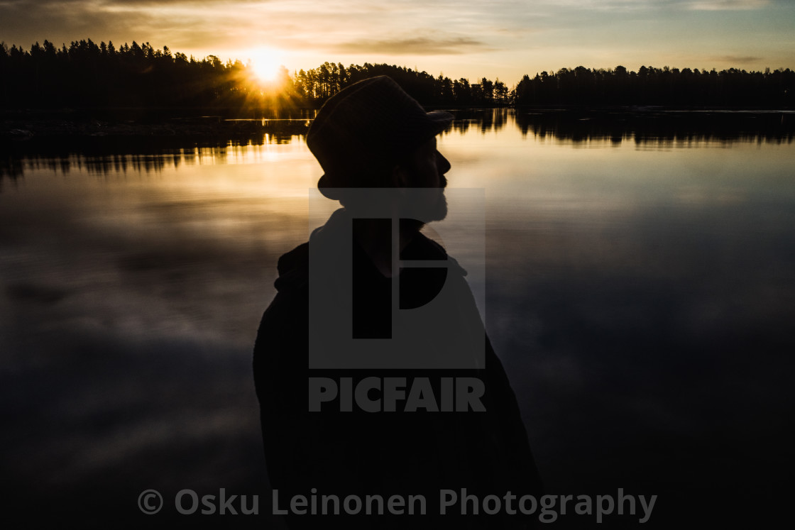 """""""A Man With A Hat VII (At The Lake In Morning)"""" stock image"""