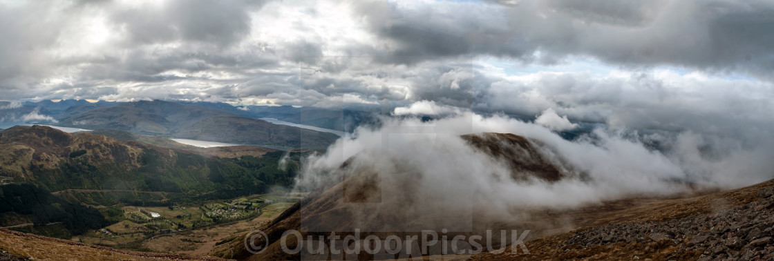 """A panoramic view of Glen Nevis as the clouds roll in at 3000ft (914m)"" stock image"