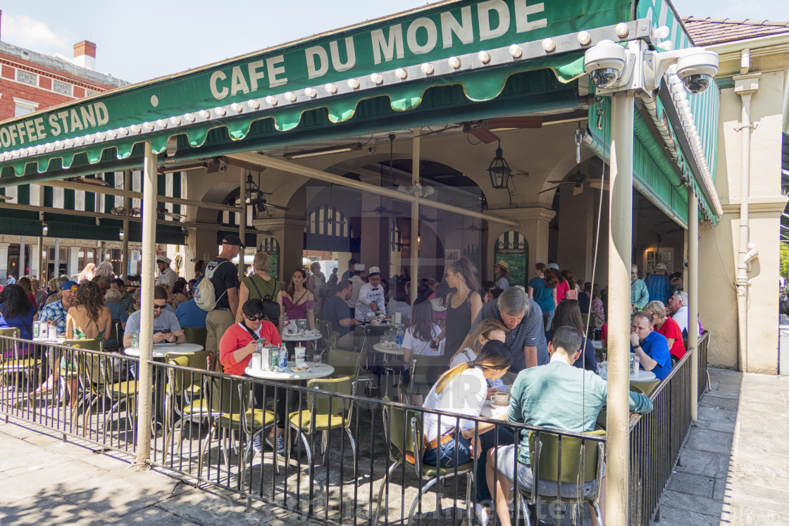 """""""Crowded Cafe du Monde in New Orleans"""" stock image"""