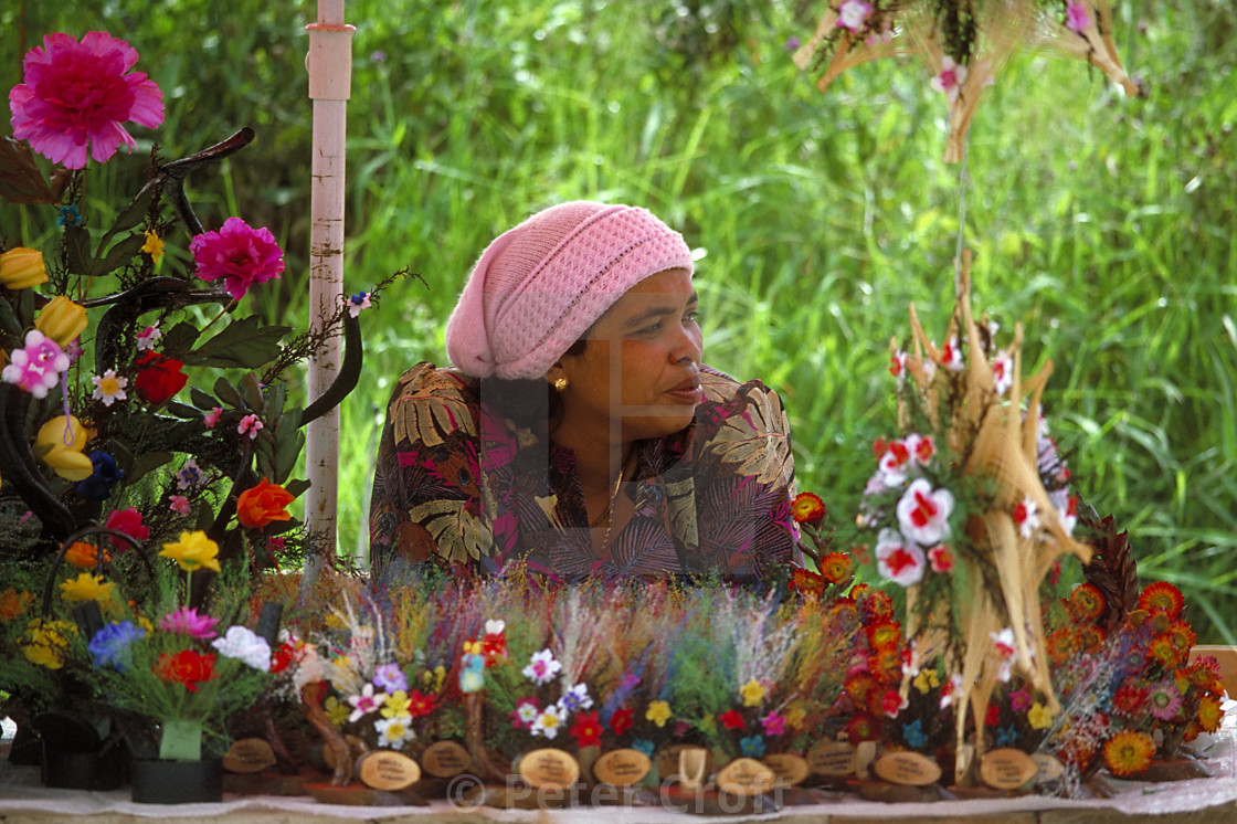 """""""A Malaysian flower seller waits for customers, 1986."""" stock image"""