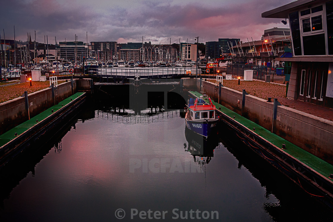 """""""The Lock At Sutton Harbour"""" stock image"""