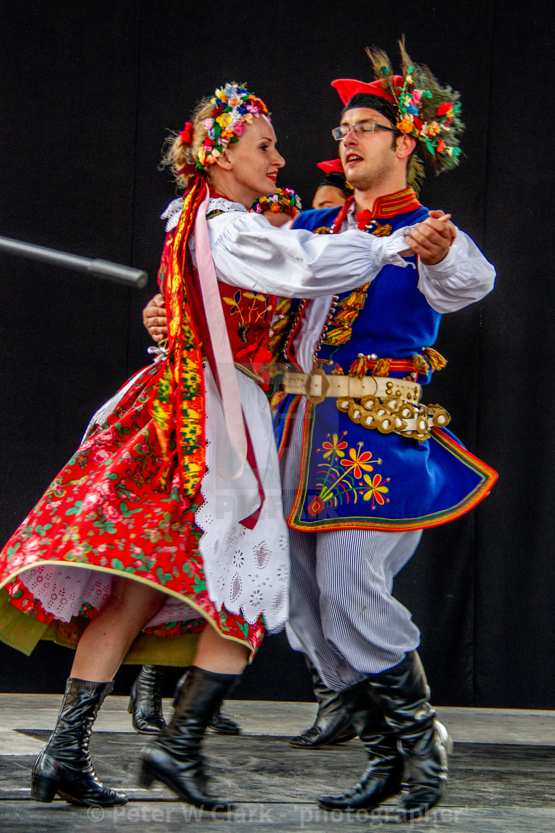 """Couple in Traditional Dress Dancing at the International Festival of Children and Youth Folk Groups. Krakow"" stock image"