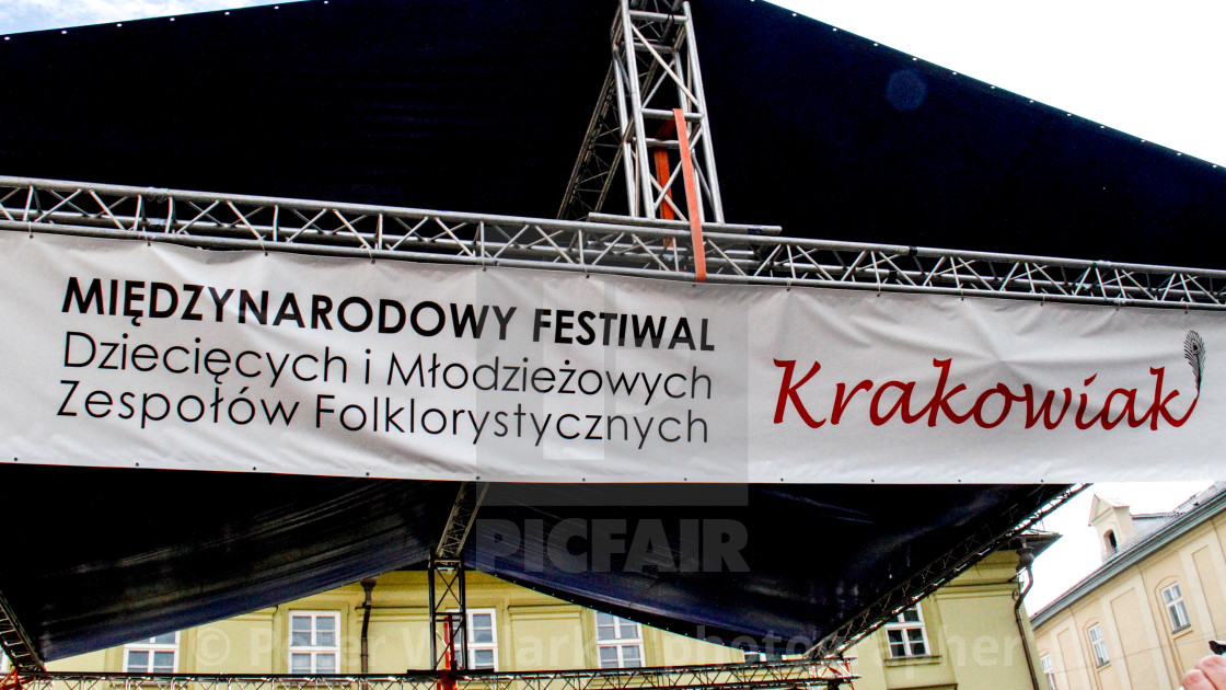 """Sign advertising the International Festival of Children and Youth Folk Groups. Krakow, Poland.2013"" stock image"