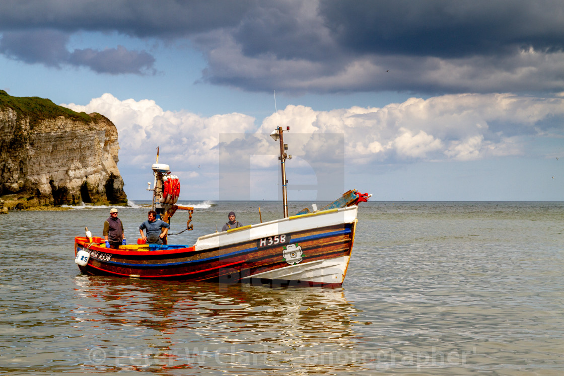 """Fishing Cobbles Unloading their Catch of Crabs at North Landing."" stock image"