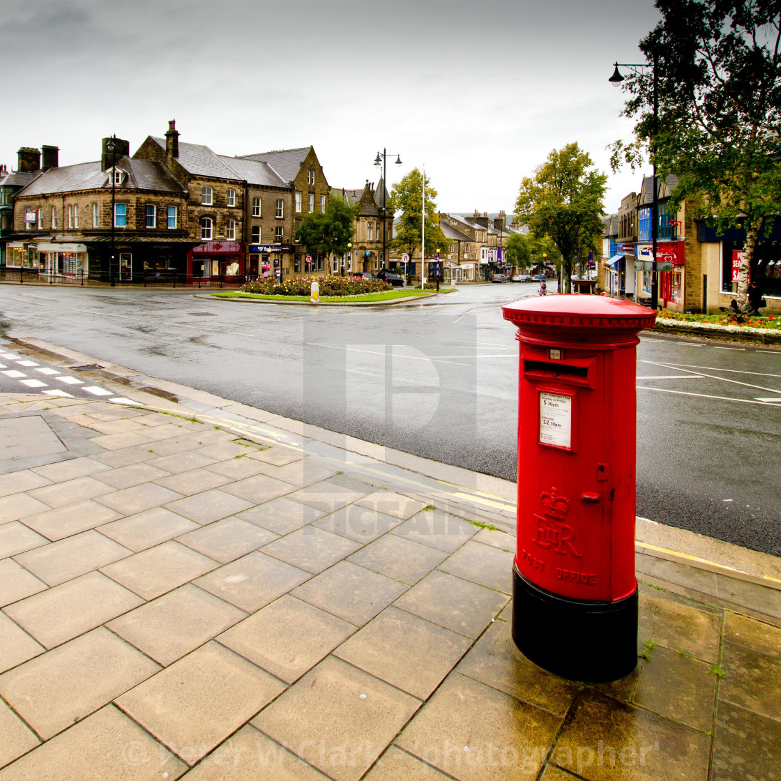 """Pillar, Postbox in the Rain, Ilkley"" stock image"