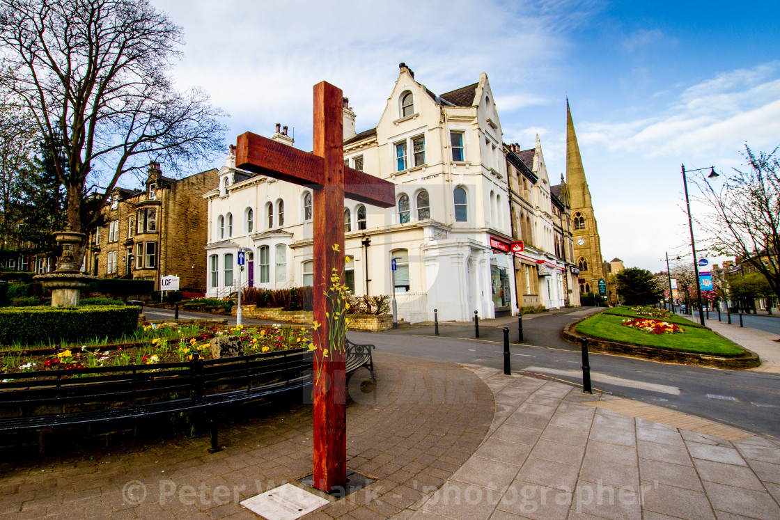"""Easter Cross with Daffodils, Ilkley"" stock image"