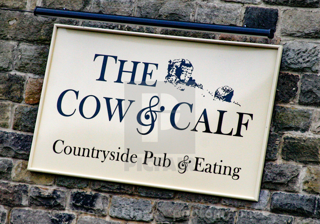 """The Cow and Calf, Ilkley, Country Pub and Eating. Wall sign"" stock image"