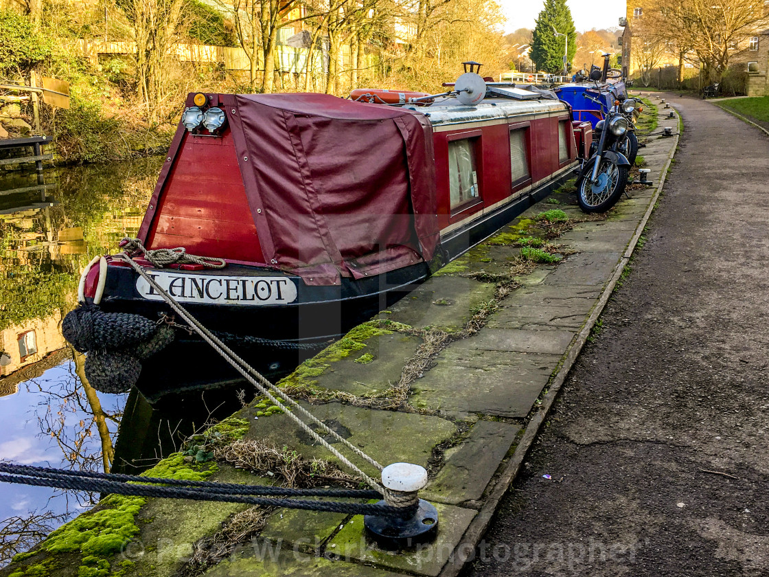 """Skipton Canal Basin on the Leeds Liverpool Canal. Narrow Boat Lancelot moored on Towpath"" stock image"