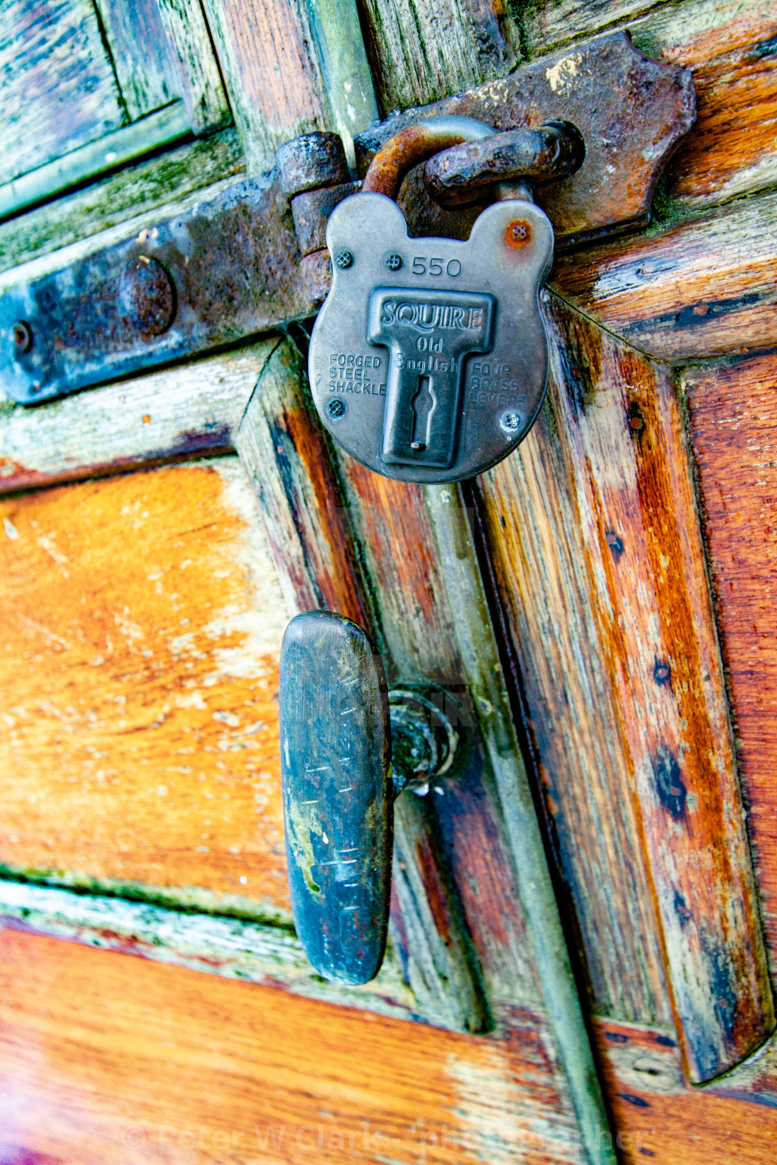 """Vintage carriage/Saloon Door and Padlock Detail on display at Embsay and Bolton Abbey Steam Railway"" stock image"