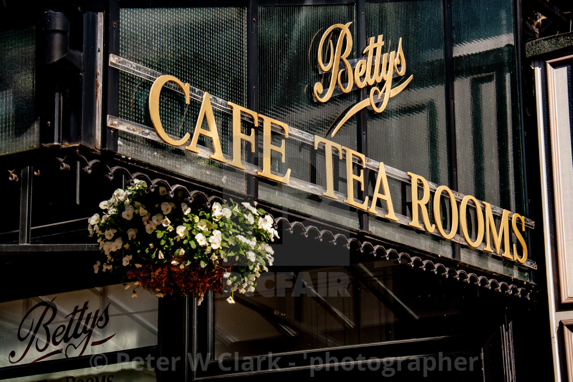 """Bettys Tea Room, Ilkley, Hanging Baskets in Full Blossom."" stock image"