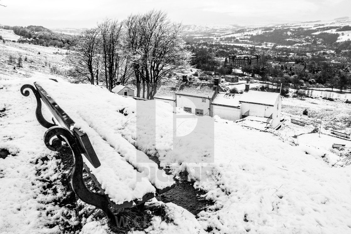 """Seat on Ilkley Moor Overlooking White Wells and Ilkley. A Winter Scene."" stock image"