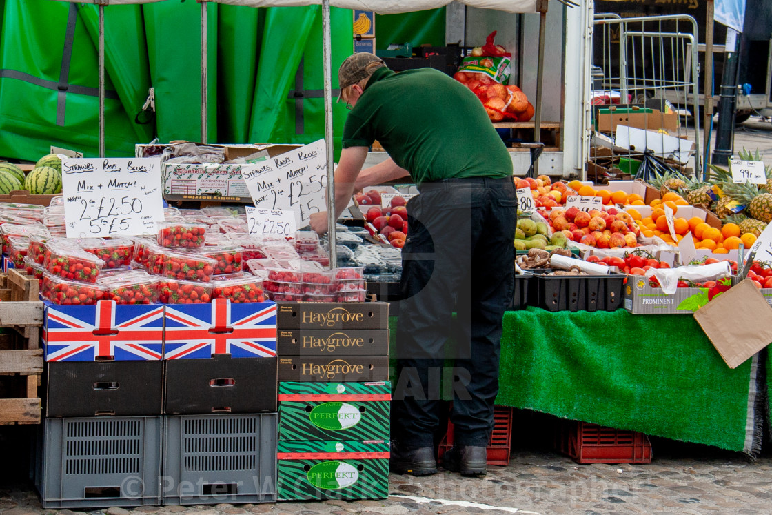 """Cobbled Market Place, market stall displaying and selling fruit.Richmond, North Yorkshire."" stock image"