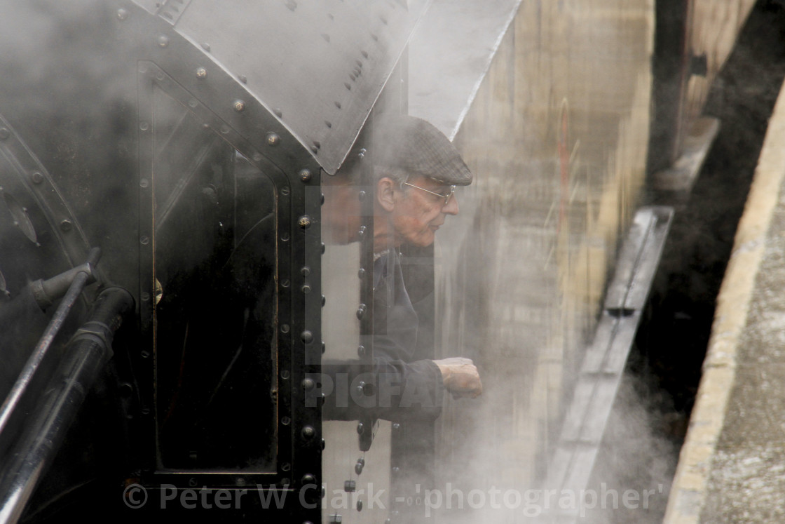 """Steam Train Driver visible through the Steam"" stock image"