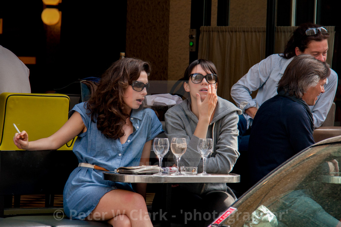 """Girls chatting at a Pavement Cafe in Paris"" stock image"