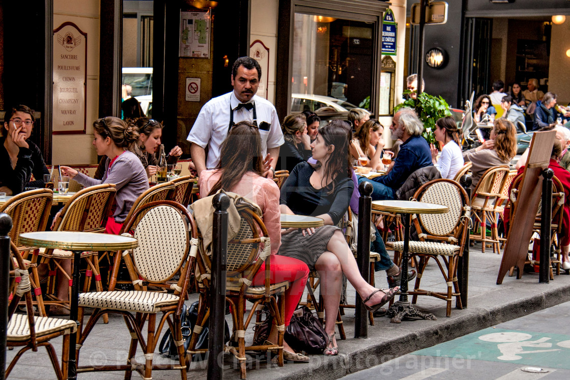 """Waiter taking the order at a Pavement Cafe in Paris"" stock image"