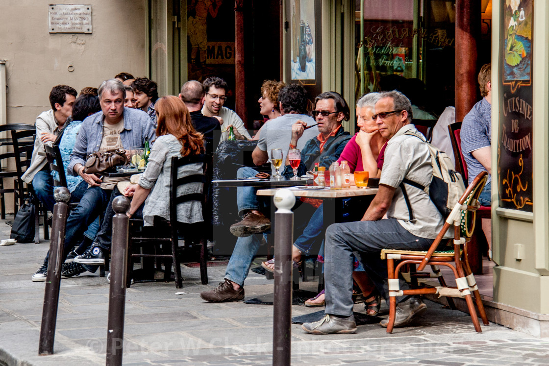 """Relaxing at a Pavement Cafe in Paris"" stock image"