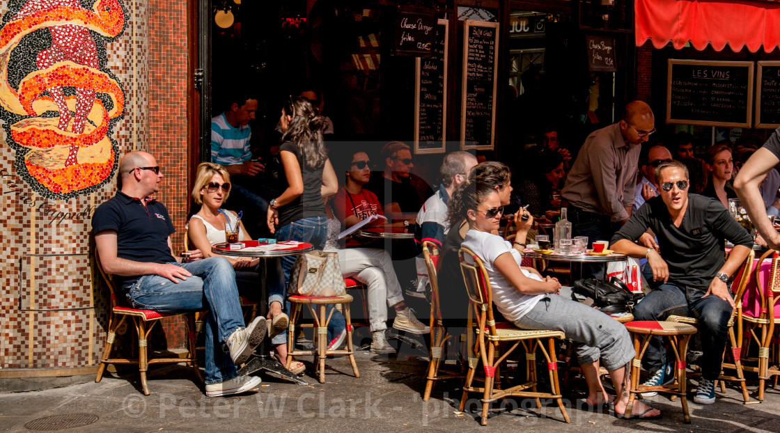Relaxing in the sun at Pavement Cafe in Paris