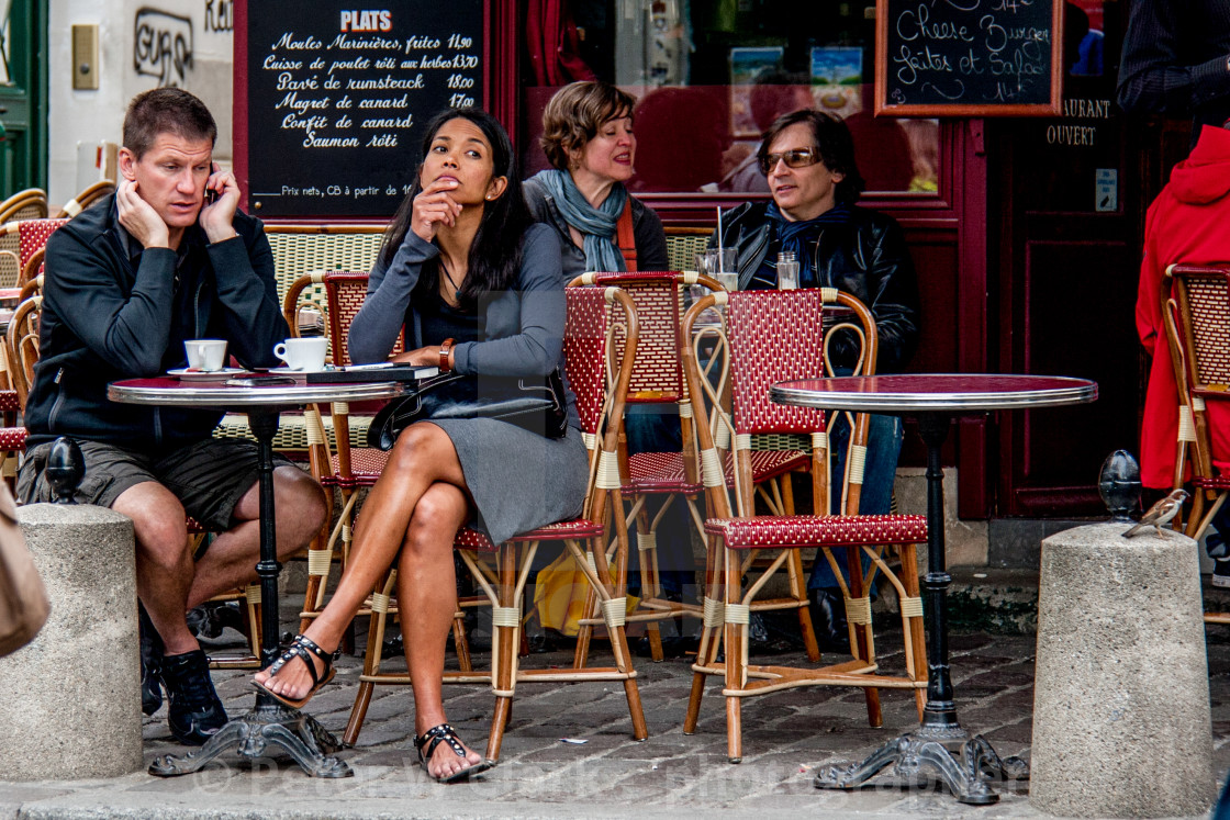"""Pavement Cafe in Paris, customer on mobile phone."" stock image"