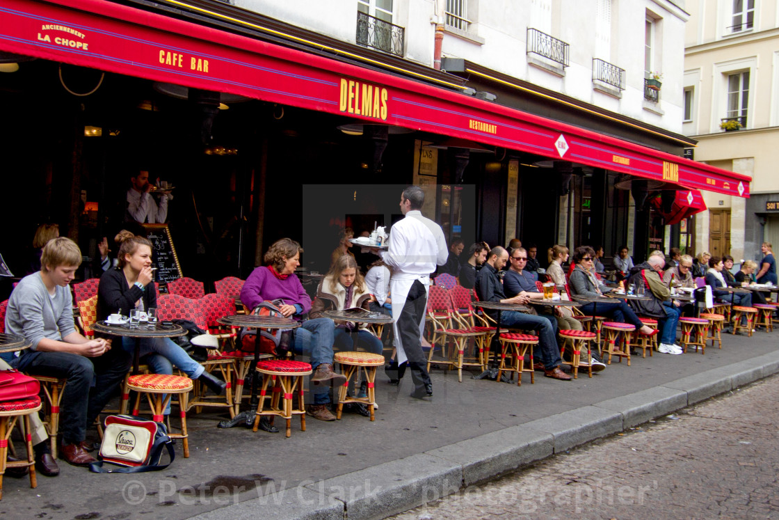 """Waiter serving Coffee at a Pavement Cafe in Paris"" stock image"