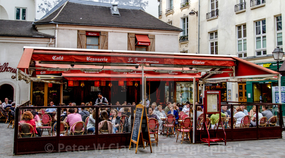 """Vibrant Pavement Cafe in Paris"" stock image"