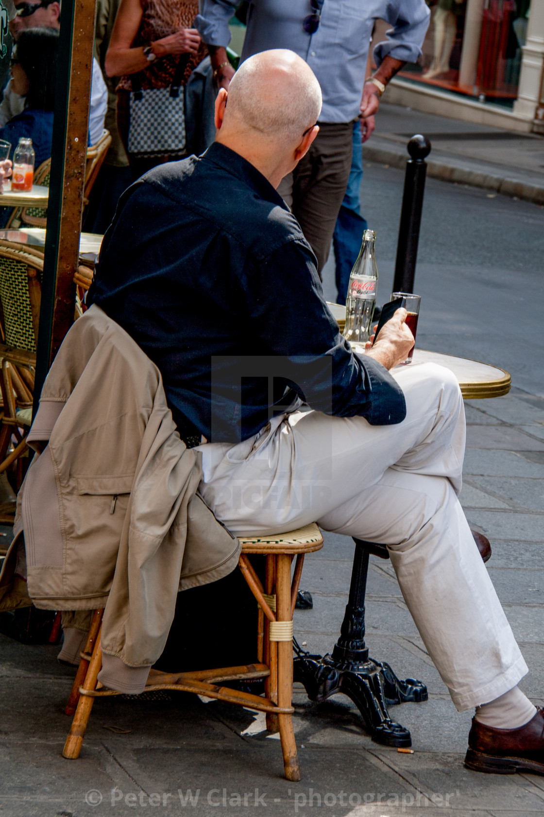 """Lonely Drink in Pavement Cafe in Paris"" stock image"