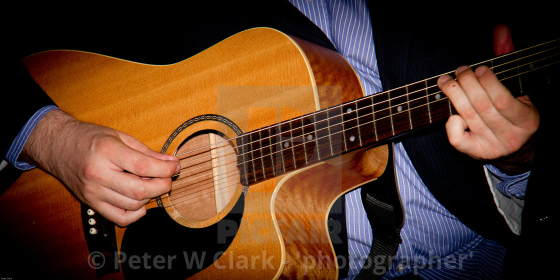 """Playing Acoustic Guitar."" stock image"