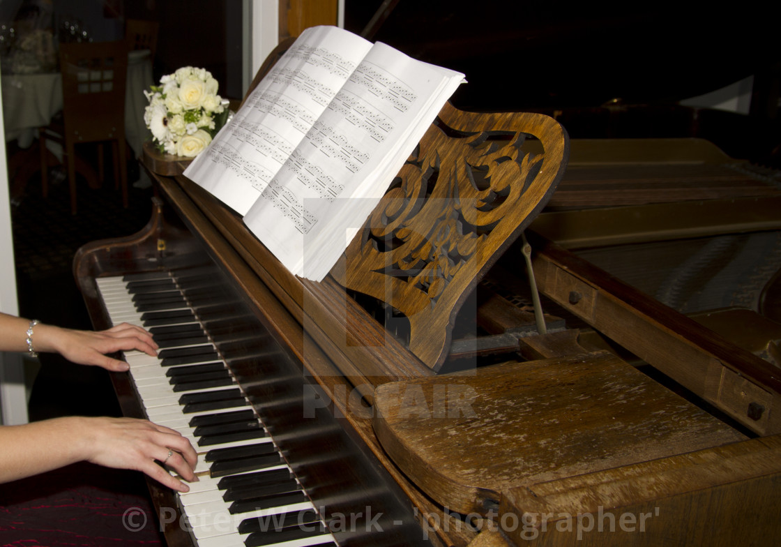 """Playing a Grand Piano"" stock image"