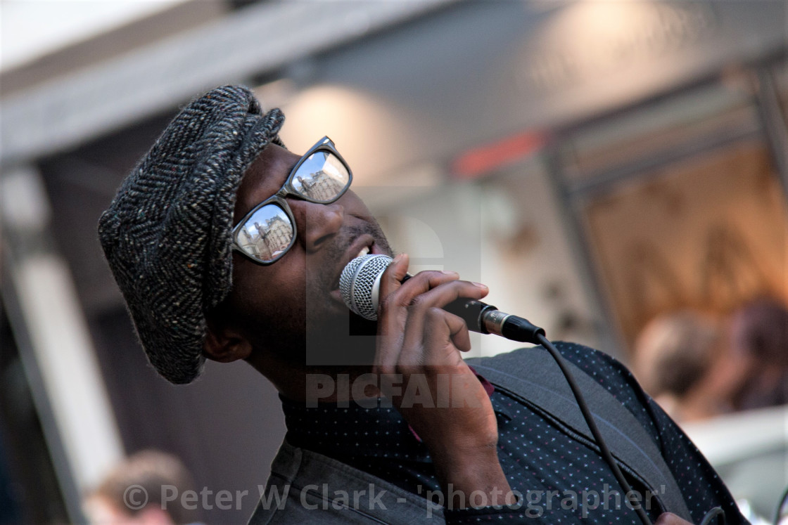 """Street Singer, Busker. Reflection in Sunglasses."" stock image"