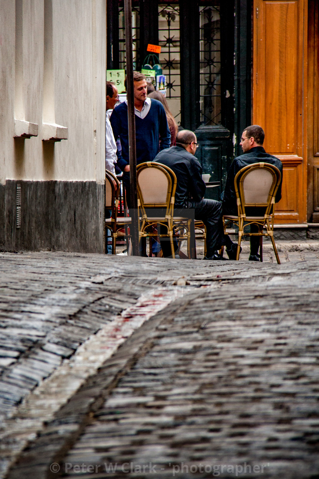 """Discussion over Coffee at a Paris Pavement Cafe."" stock image"
