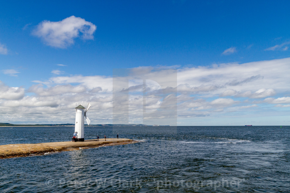 """""""Swinoujscie, Photographs of a Polish Seaport. Windmill/lighthouse at the entry to the port of Świnoujście"""" stock image"""