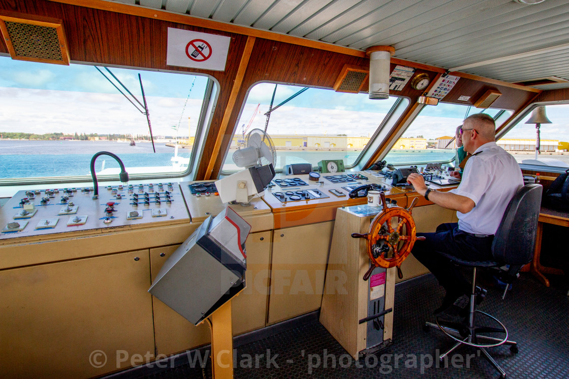 """Swinoujscie, Photographs of a Polish Seaport. MS/Chateaubriand, Captain on the Bridge."" stock image"