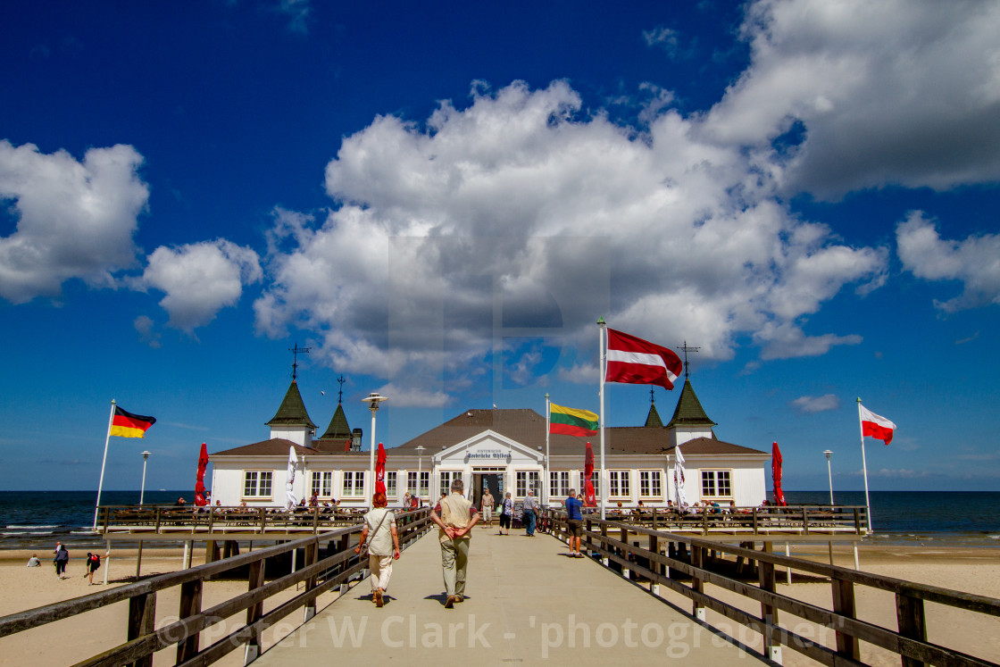 """Photographs of Ahlbeck a Seaside Resort on the Baltic Sea Coast, Germany. View of the the wooden Pier Buildings and Flags."" stock image"