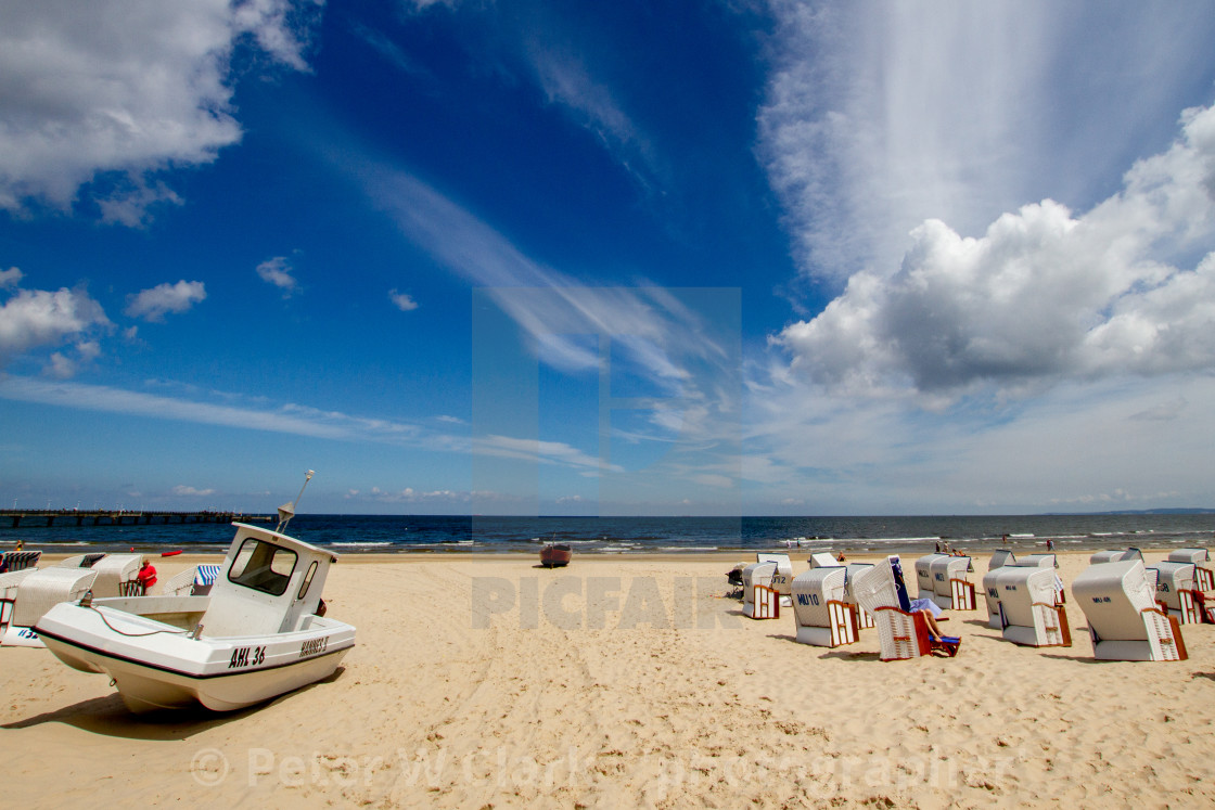 """Photographs of Ahlbeck a Seaside Resort on the Baltic Sea Coast, Germany. The Beach with Wicker Sun Shelters on a Sunny Day. Fishing boat to side,"" stock image"
