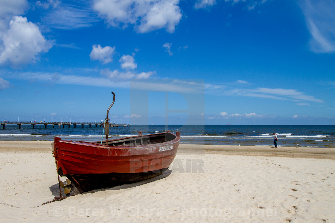 """Photographs of Ahlbeck a Seaside Resort on the Baltic Sea Coast, Germany. The Beach on a Sunny Day. Fishing Boat Seeadler to the Forground."" stock image"