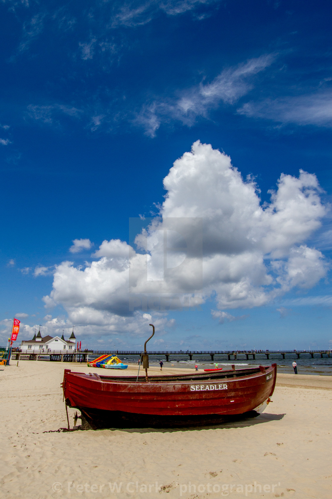 """Photographs of Ahlbeck a Seaside Resort on the Baltic Sea Coast, Germany. The Beach on a Sunny Day. Fishing Boat Seeadler to the Forground. Pier and Pavillion in the Background."" stock image"