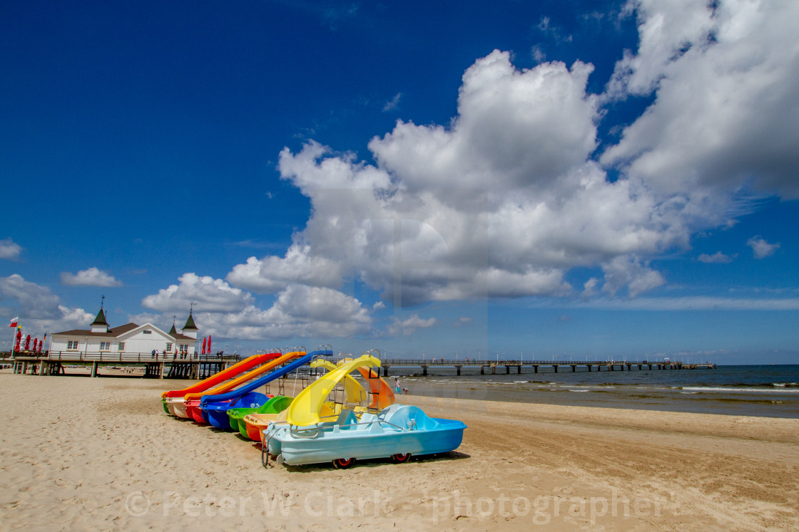 """Photographs of Ahlbeck a Seaside Resort on the Baltic Sea Coast, Germany. The Beach on a Sunny Day. Pedal Boats with Water Slides to Foreground."" stock image"
