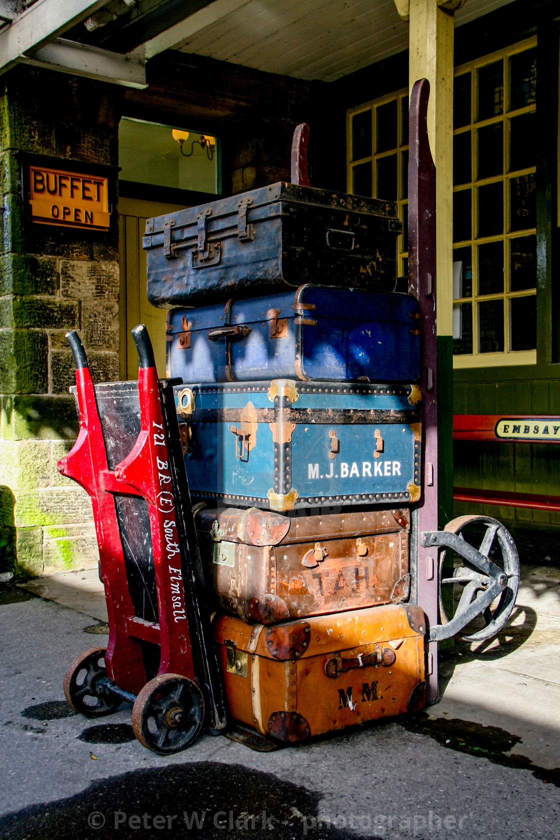 """Embsay and Bolton Abbey Steam Railway. Porters Baggage Trolley and Old Suitcases."" stock image"