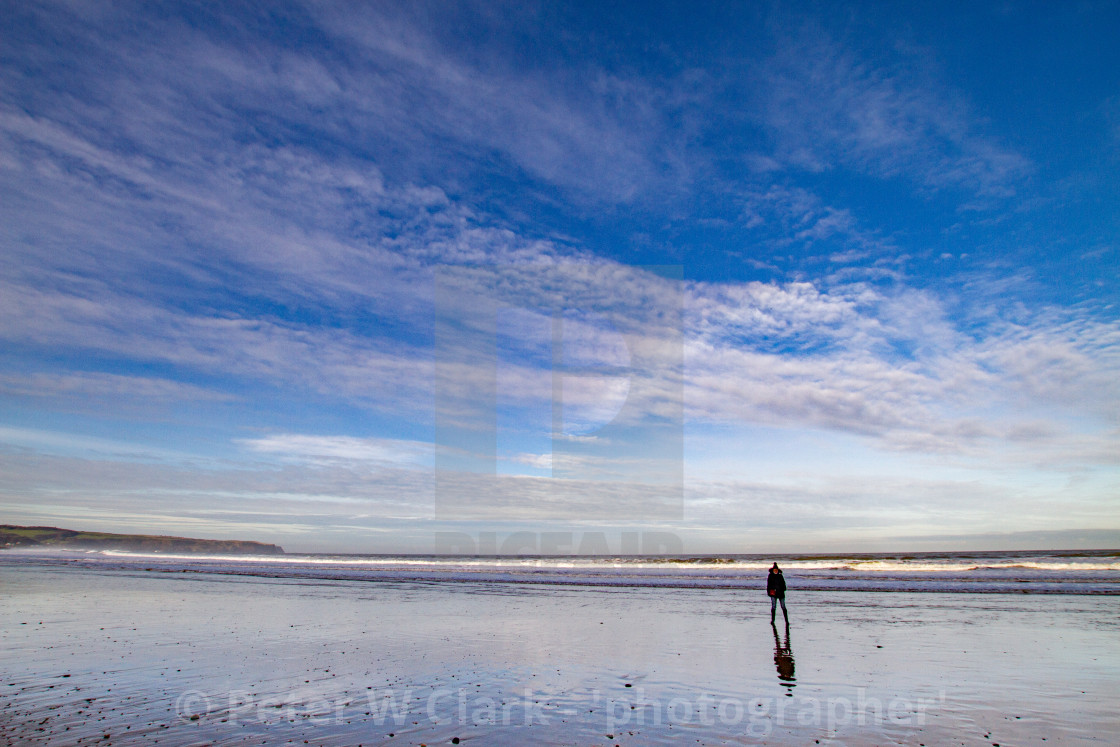 """Whitby, UK, Beach, Lone Walker and Reflection. Blue Sky and Copy Space."" stock image"