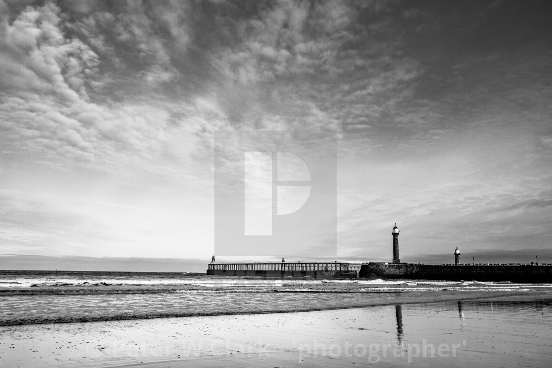 """Whitby, UK, Beach, Pier,lighthouse and Reflection. Monochrome and Copy Space."" stock image"