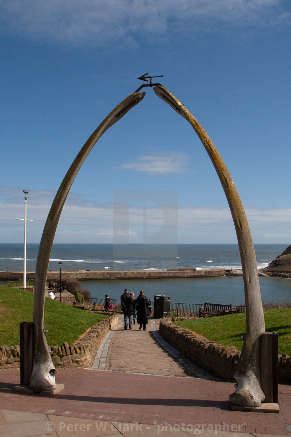 """Whitby,UK,Yorkshire,East coast, Monument, the Whalebone Arch. With pier and sea in the background."" stock image"